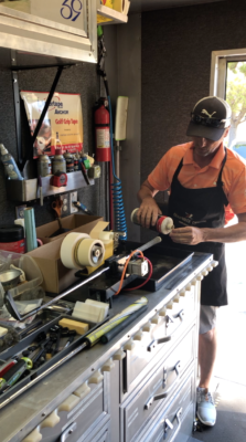 Brendan Bergin changing a grip at High Performance Golf Institute
